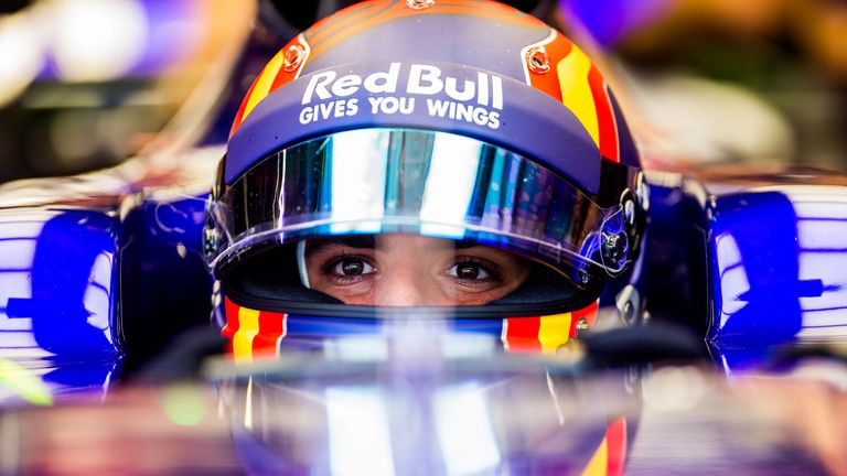 Carlos Sainz sits in his Toro Rosso during practice for the Formula One Austrian Grand Prix