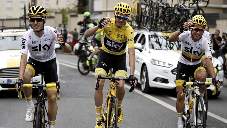 Froome (centre) celebrated with team-mates on the final stage