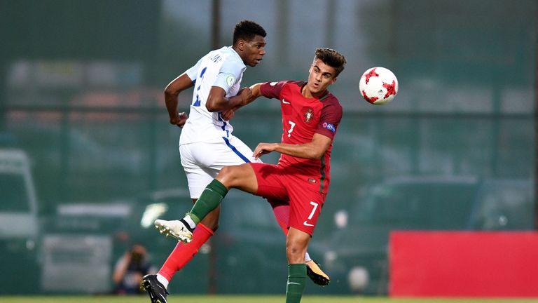 Dujon Sterling of England and Joao Filipe of Portugal battle for the ball