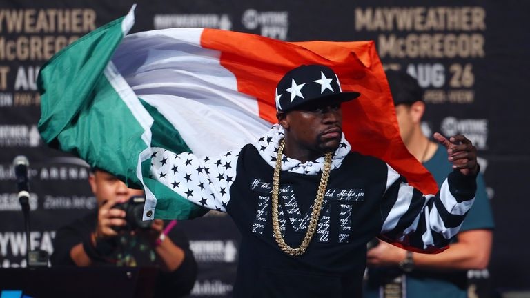 Mayweather came on stage draped in an Irish flag