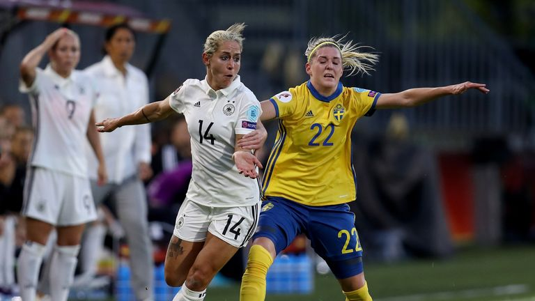 Anna Blaesse (left) of Germany battles for possession with Olivia Schough
