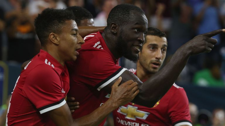 Lukaku celebrates his opening goal with his United team-mates