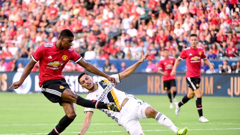 Rashford scores his second goal of the game past Hugo Arellano of LA Galaxy