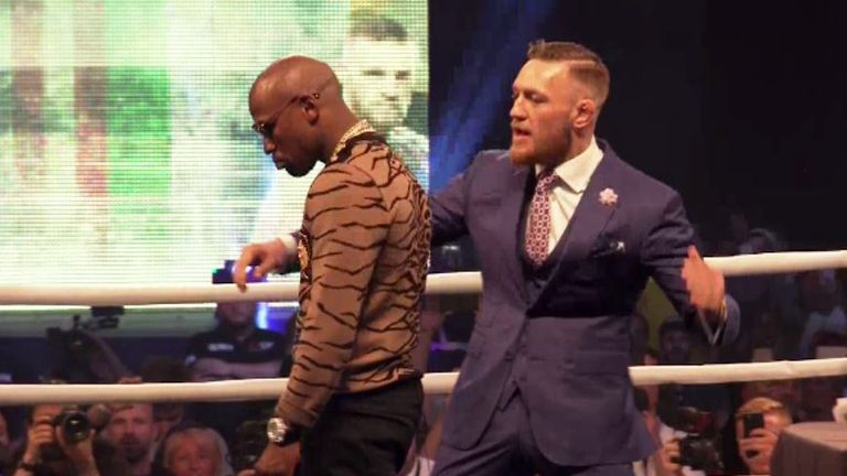 Mayweather had to walk past McGregor as he entered the ring