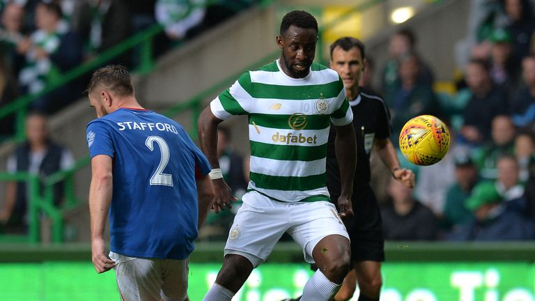 Celtic striker Moussa Dembele is challenged by Linfield's Mark Stafford