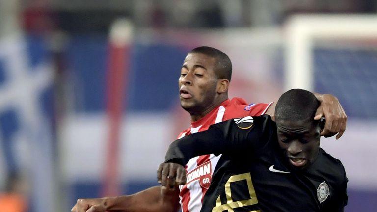 Osmanlispor's Badou Ndiaye holds off Olympiakos' midfielder Seba