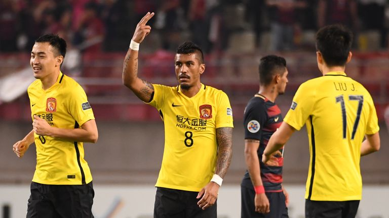 Paulinho celebrates scoring for Guangzhou Evergrande who have turned down a bid for the midfielder