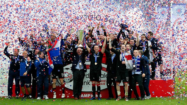 Rangers celebrate with the SPL trophy in 2011