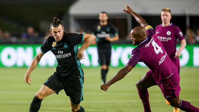 Gareth Bale gets past Vincent Kompany in the first half in LA