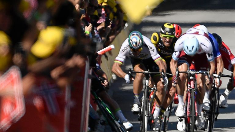 Peter Sagan (second left) causes a crash that sends Mark Cavendish (far left, obscured) into the barriers