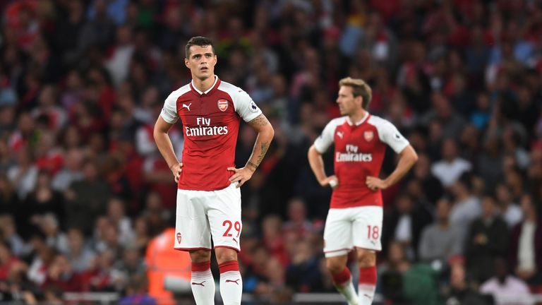 Granit Xhaka and Nacho Monreal stand dejected after Jamie Vardy put Leicester ahead on Friday Night Football