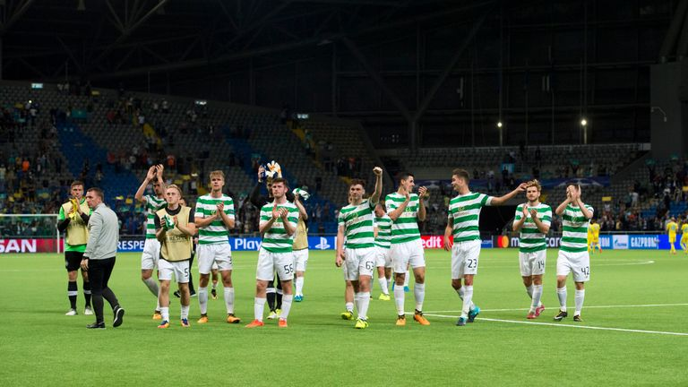 Celtic players celebrate at full-time after making the Champions League group stages