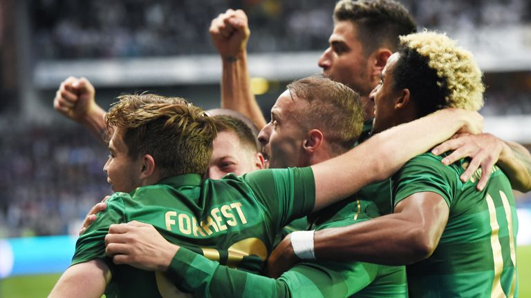 Celtic's players mob Forrest after his goal