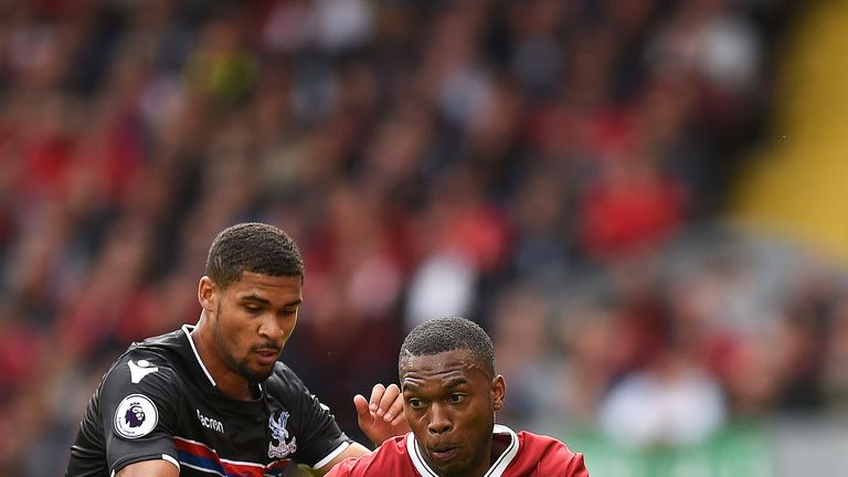 Daniel Sturridge looks to break under pressure from Ruben Loftus-Cheek