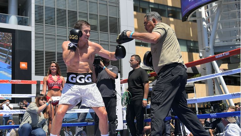 Golovkin works the pads with trainer Abel Sanchez at the public workout