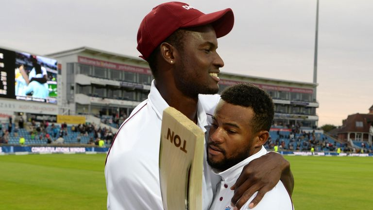 Captain Jason Holder embraces man-of-the-match Hope at Headingley
