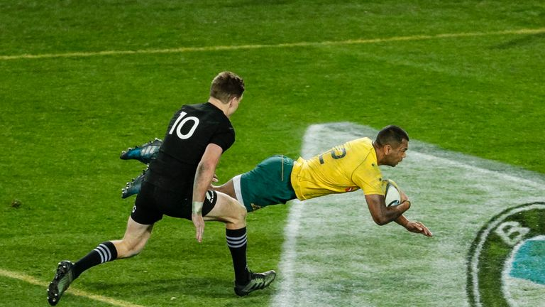 Kurtley Beale dives over for a try in last weekend's meeting between the two