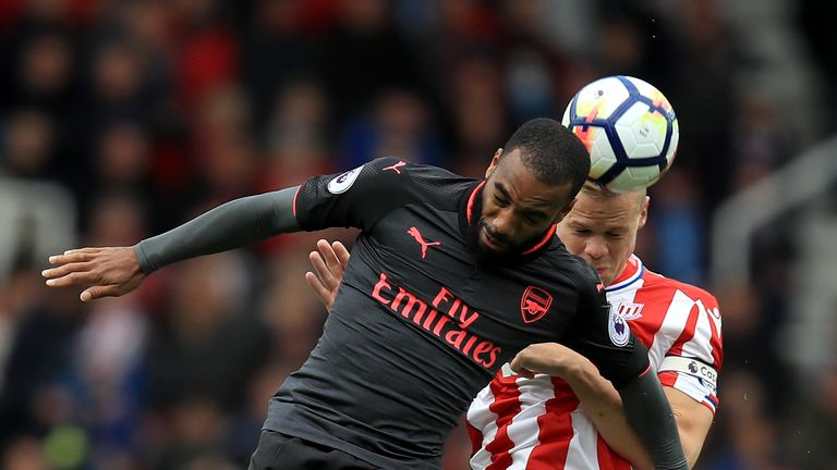 Alexandre Lacazette (L) and Ryan Shawcross battle for the ball