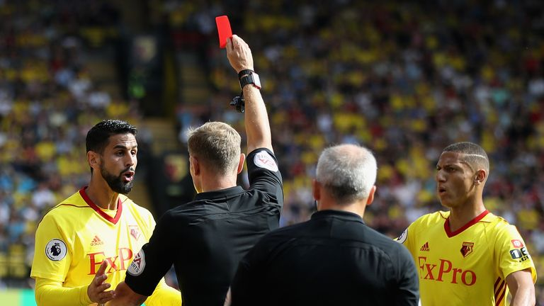 Graham Scott shows a red card to Miguel Britos of Watford