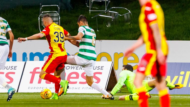 Miles Storey goes down under a challenge from Nir Bitton - but the referee was unmoved