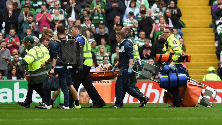 Murray Davidson is stretchered off at Celtic Park