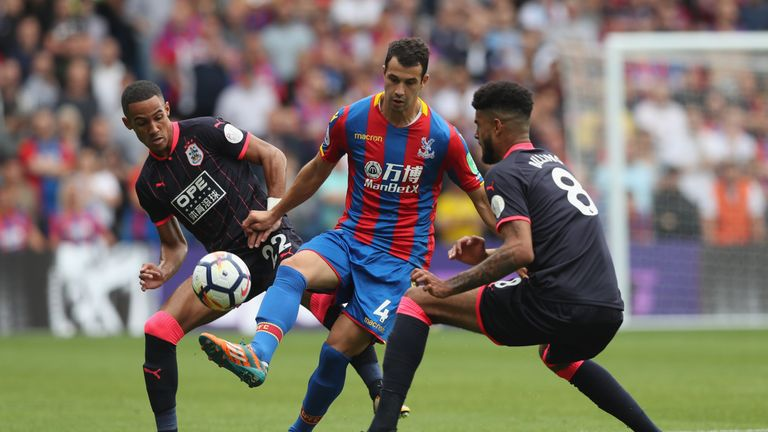 Luka Milivojevic under pressure from Tom Ince and Philip Billing