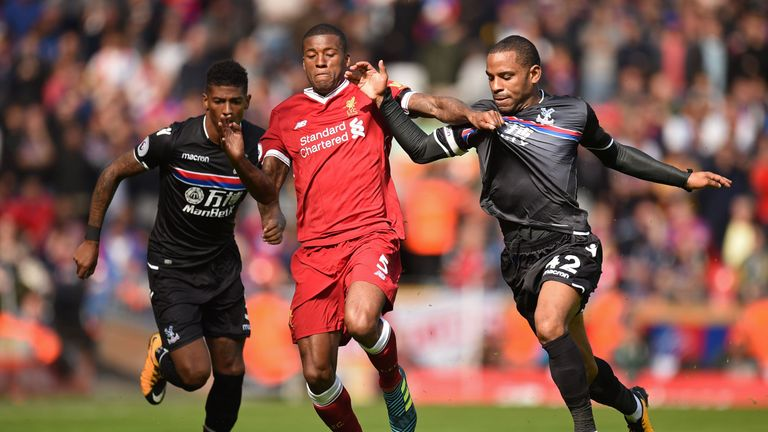 Georginio Wijnaldum vies for possession with Jason Puncheon