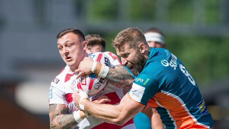 Matty Dawson is tackled by Scruton