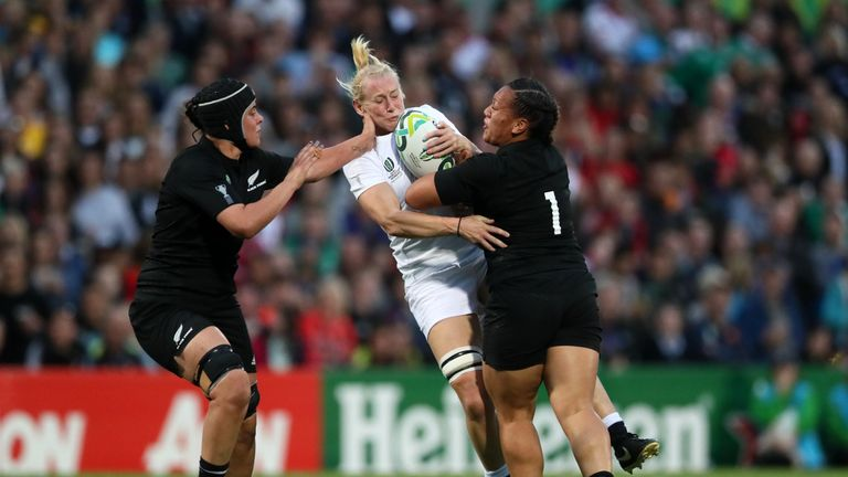 England's Tamara Taylor is tackled by New Zealand's Toka Natua (right) and Eloise Blackwell