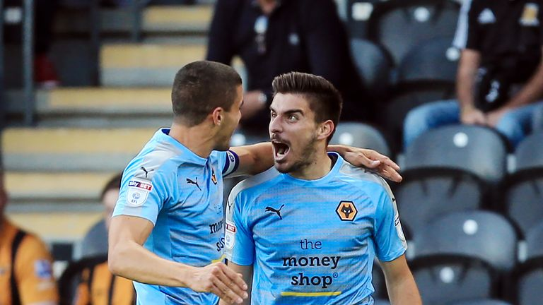 Wolverhampton Wanderers' Ruben Neves (right) celebrates scoring his side's first goal against Hull