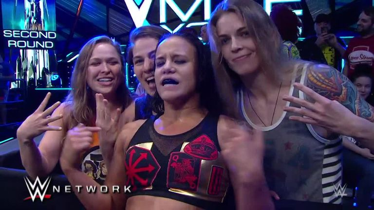 The love of WWE from Rousey's friend Shayna Baszler (second right) was vital to her switching careers
