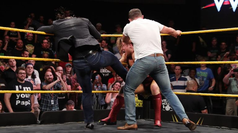 Pete Dunne received a beating from Adam Cole and Bobby Fish before leaving Wolfgang to face them alone