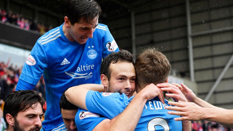Aberdeen's Andy Considine (centre) savours his decisive intervention at Fir Park