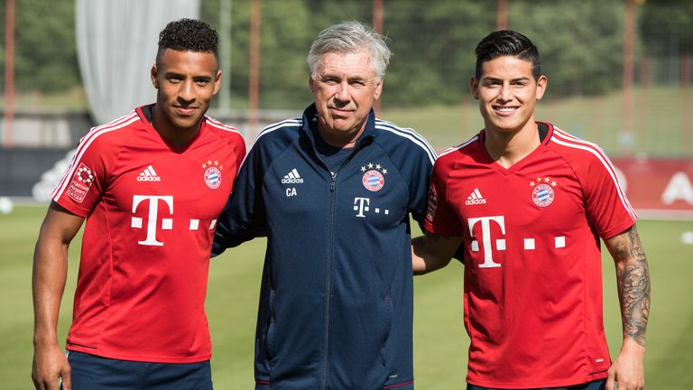 Ancelotti poses with Corentin Tolisso and James Rodriguez as Bayern boss