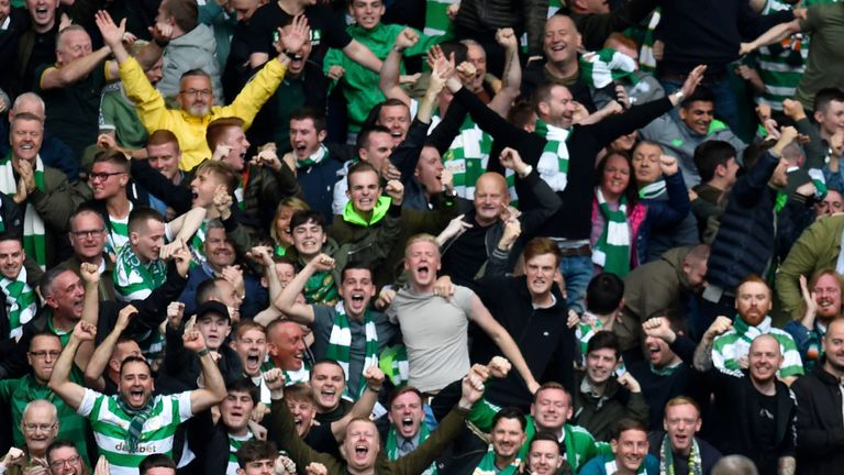 Celtic's players and supporters celebrate Tom Rogic's opener against Rangers
