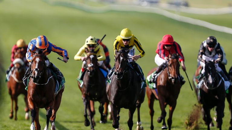 Clemmie (L) wins the Juddmonte Cheveley Park Stakes