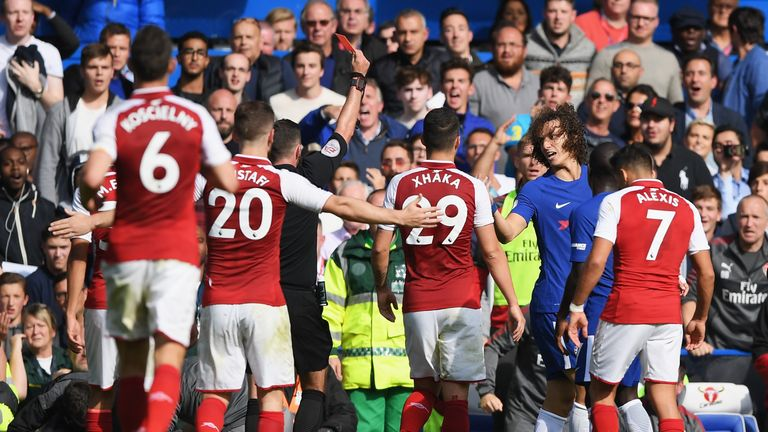 David Luiz is shown a red card by referee Michael Oliver