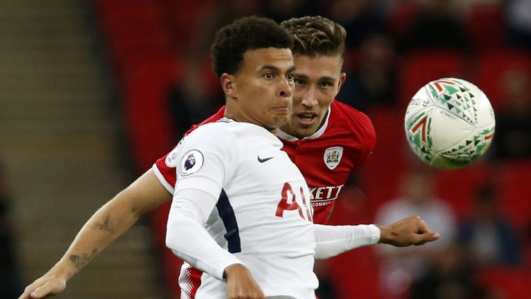 Dele Alli (L) vies with Barnsley's English defender Angus MacDonald