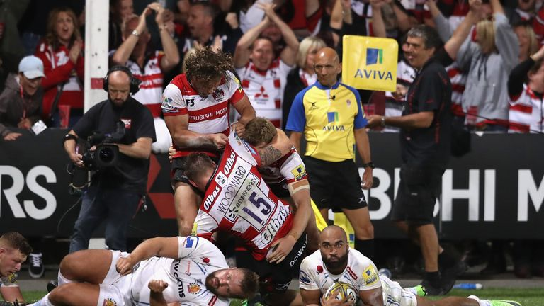 Gloucester celebrate after Jason Woodward scores a last minute winning try over champions Exeter