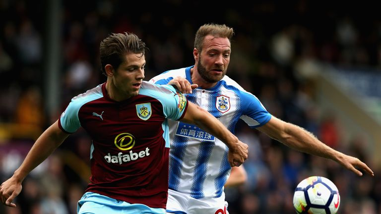 James Tarkowski challenges Laurent Depoitre for the ball during the Premier League game