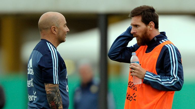 Messi (right) in discussion with his coach Jorge Sampaoli