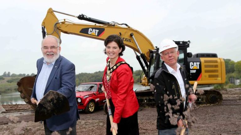 Francie Molloy (MP for Mid Ulster),  Councillor Kim Ashton (Chair of Mid Ulster District Council) and David Henderson (Manna Developments) dig the first parts of the track