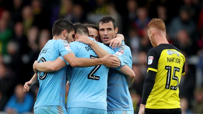 Bonatini celebrates with team-mates after putting Wolves 4-0 up away to Burton