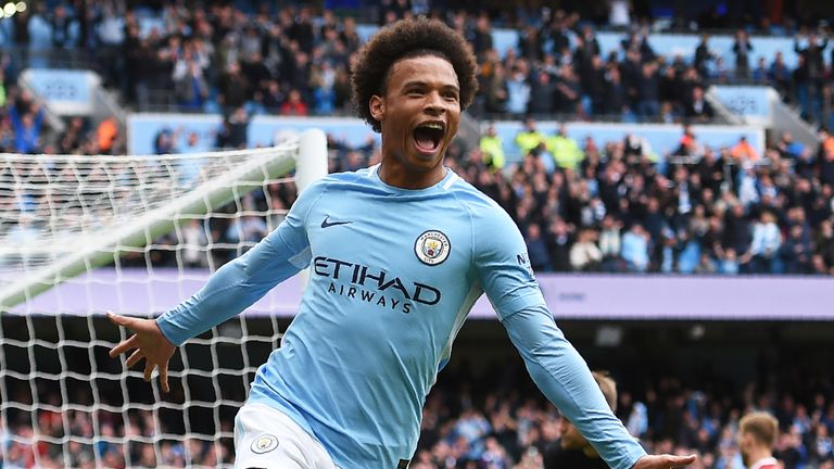 Leroy Sane celebrates after scoring Manchester City's fourth goal during the Premier League match against Liverpool