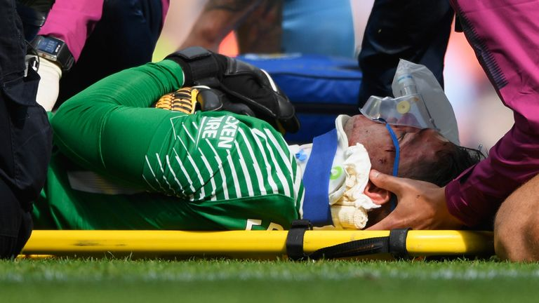 Ederson receives treatment on the pitch after colliding with Sadio Mane, but was back in action a few days later