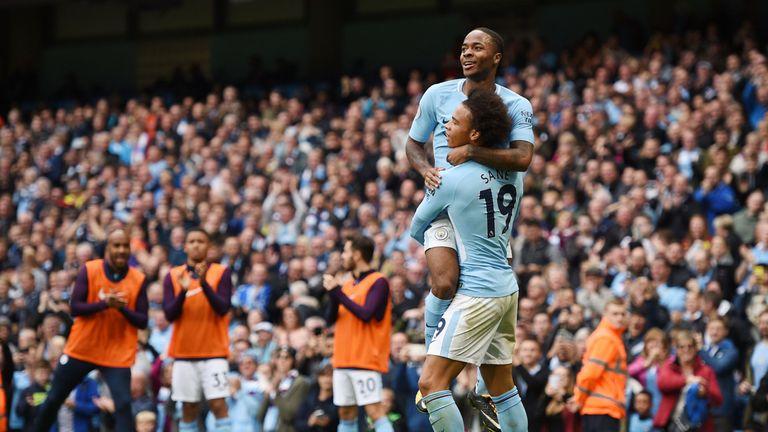 Raheem Sterling (top) celebrates scoring with Leroy Sane