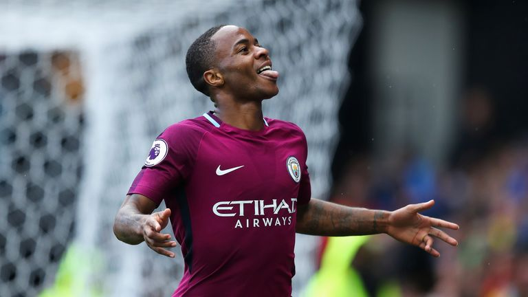 Raheem Sterling celebrates after converting from the penalty spot