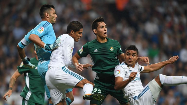 Real Madrid's Raphael Varane (second left) and Casemiro (right) vie with Real Betis' defender Aissa Mandi and Antonio Adan