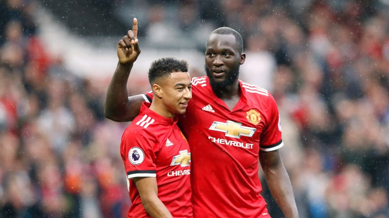 Manchester United striker Romelu Lukaku (right) will hope to continue his recent good form against Crystal Palace