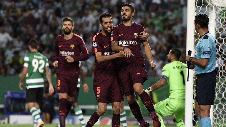 Sergio Busquets and Luis Suarez celebrate after scoring